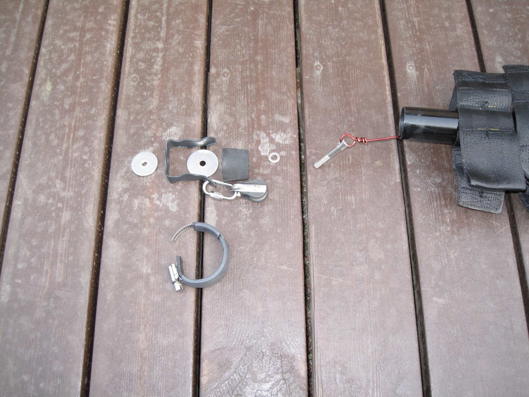 Top plug and pulley attachment before assembly